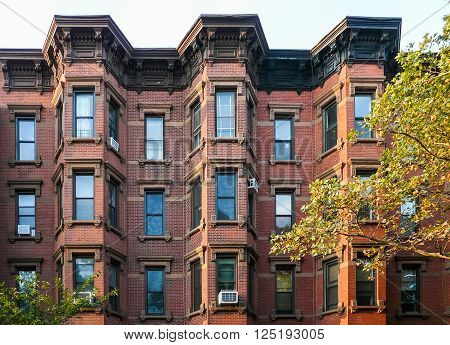 Brooklyn New York - August 16 2014: Front of residential brick house at Kent Street in Greenpoint.