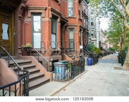 Brooklyn New York - August 16 2014: Stairs and portals of residential brick houses at Kent Street in Greenpoint.