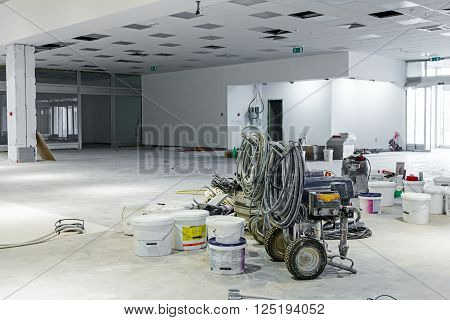 Pile of equipment for professional airless spray after job is done.