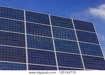 Photovoltaic solar panels on a background of blue sky ** Note: Visible grain at 100%, best at smaller sizes