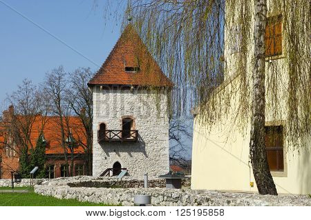 Wieliczka, Poland - April 04, 2016: Saltworks Castle. On the right fragment of the Castle South of the nineteenth century. In the middle stands the tower of the fourteenth century. On the left Wieliczka district Office.
