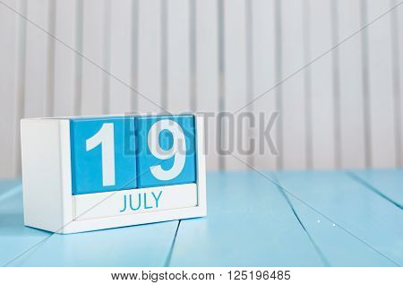 July 19th. Image of july 19 wooden color calendar on white background. Summer day. Empty space for text.