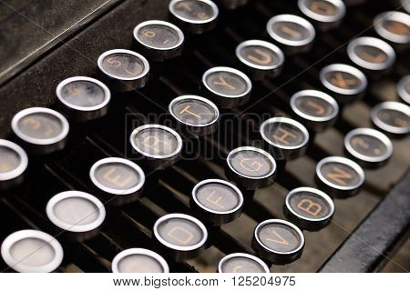 Close up photo of antique typewriter keys shallow focus