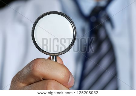 Medicine Doctor Hand Hold Stethoscope Head In Front Of His Chest
