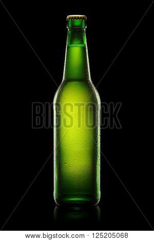 Green wet Bottle of beer isolated on black background. With clipping path.