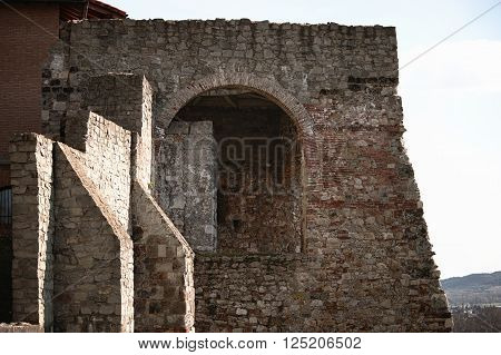 Fragment of old stone bastion with doorway and passages. Cathedral in Hungary, Estergom.