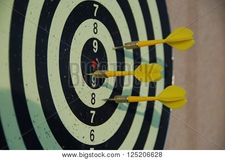 Yellow darts missing target, concept