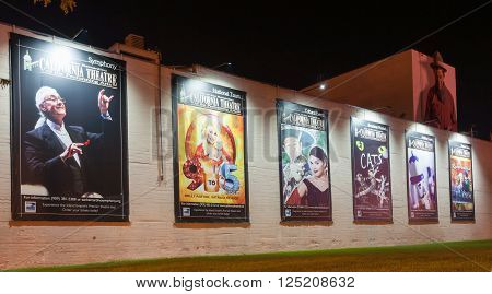 San Bernardino, California, USA - October 3, 2015: Musical show posters on exterior wall of California Theatre of the Performing Arts illuminated at the theater in San Bernardino, California, USA.Bernardino California USA.