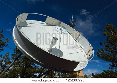 Old Large C-Band Communications Satellite Dish on a Sunny Day