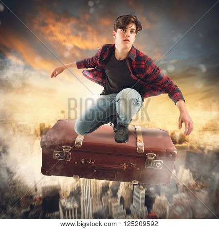 Boy flies on suitcase over the city
