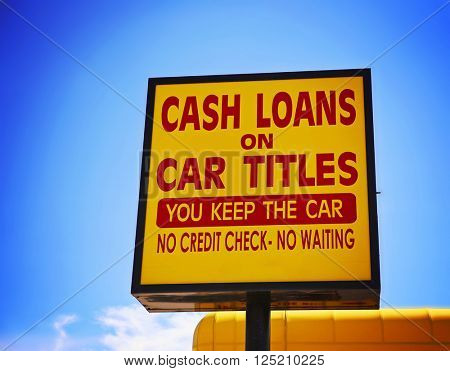 a cash loan or car title loan sign in the summer time toned with a retro vintage instagram filter app or action effect