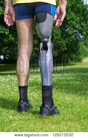 Rear View On False Leg Of Man Standing On Grass