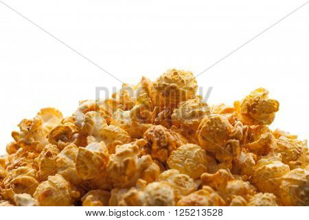 caramel pop corn background with white copy-space