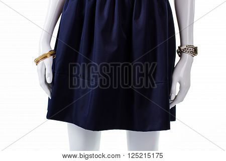 Mannequin in blue navy skirt. Navy cotton skirt with folds. Female wrist accessories with skirt. Dark new piece of clothing.