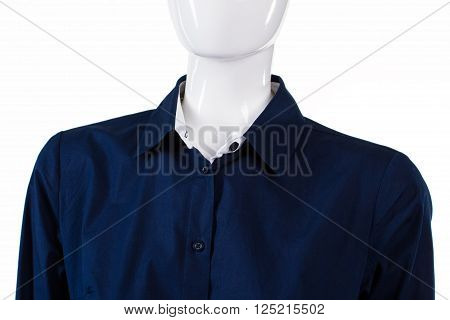 Navy formal shirt on mannequin. Lady's plain formal shirt. Dark shirt with unbuttoned collar. Navy official shirt on display.