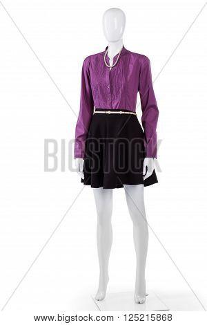 Purple shirt and black skirt. Female mannequin wearing purple shirt. Stylish long sleeve shirt. Woman's colorful shirt on display.