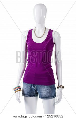 Female mannequin in purple top. Woman's purple cotton tank top. Simple comfortable clothing on display. Sale of trendy summer apparel.