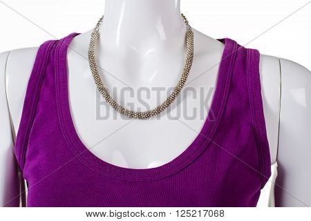 Purple top with silver necklace. Woman's silver jewelry on mannequin. Beautiful silver necklace on showcase. New expensive merchandise.