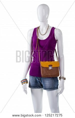 Woman's top and bicolor bag. Bicolor purse on white mannequin. Colorful bijouterie with new clothing. Good color combination for clothes.