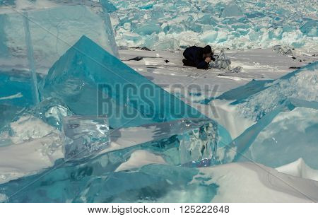 Photographer shoot blocks of ice. Beautiful winter landscape in the Lake Baikal.