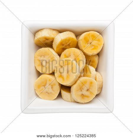 Sliced banana in a square bowl isolated on white background