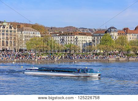 Zurich, Switzerland - 10 April, 2016: view on Utoquai quay across Lake Zurich with MS. Regula passing. Zurich is the largest city in Switzerland and the capital of the Swiss canton of Zurich.