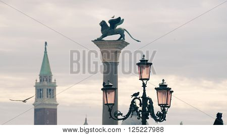 scenic Venice skyline at St.Mark square with focus on city lamp