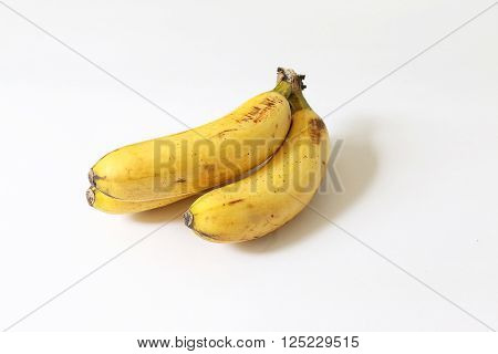 Ripe banana with brown spots on white isolated background