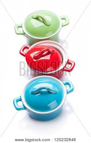 Colorful saucepans. Isolated on white background