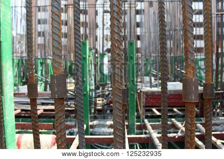 Rebar and steel coupler for wall structure building construction