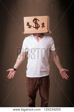 Young man standing and gesturing with a cardboard box on his head with dollar signs