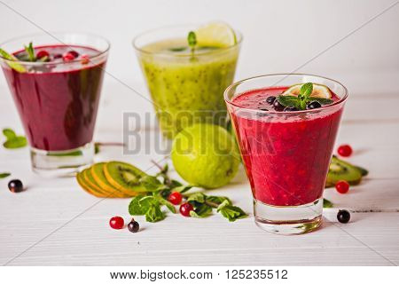 fresh berry smoothies fruit shake with ingredients. healthy veggie food. no sugar diet and detox concept.