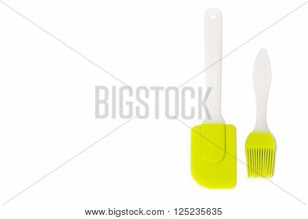 Pastry silicone set (spatula and brush) over white background
