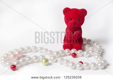 puppy wearing necklaces isolated on a pink background