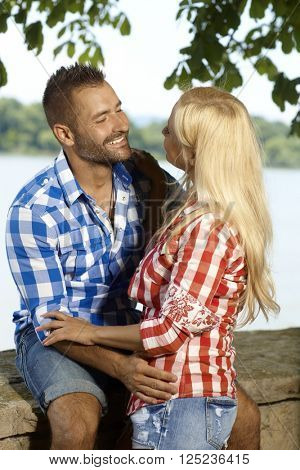 Happy married caucasian casual couple feeling romantic outdoor. Smiling, blonde woman.