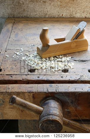Planer And Sawdust In An Antique Wooden Workbench With Vise