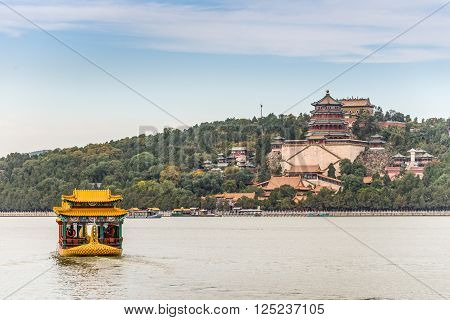 Beijing China - October 14 2013: Tourists visiting the Summer Palace are transported across the Kunming Lake on a motorboat.