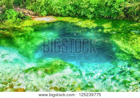 Beautiful turquoise spring Blue Eye (Syri i Kalter) near a town of Muzine, Albania. The spring is very powerful,  cold and deep and is a source of a river Bistrice