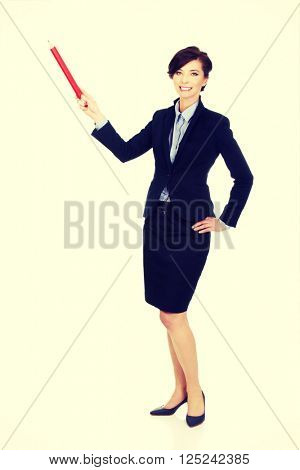 Businesswoman pointing up with pencil.
