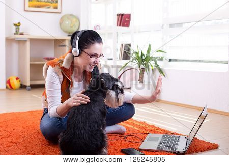 Girl With Dog Using Video Call On Laptop