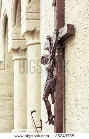 Crucifixion of Jesus Christ on church wall. Architectural element. Christian symbol.