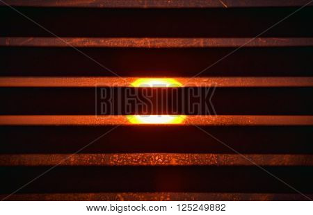 View at the sun across the sunblind during beautiful sunset