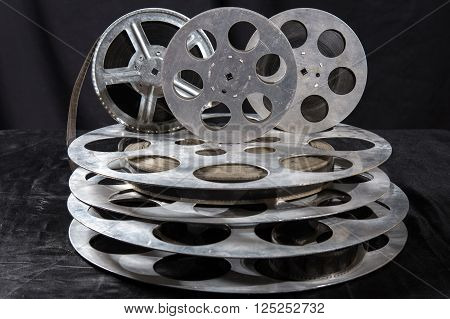 five Movie reel on a black background