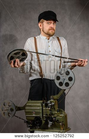 Cameraman with with a old film projection