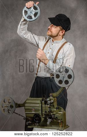 Cameraman with a film projection see on reel