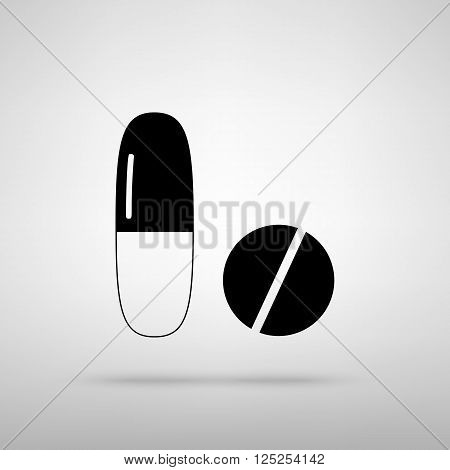 Medical pills sign. Black with shadow on gray.