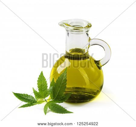 Hemp oil n a glass jar isolated on a white background