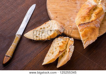 White french baguette on a wooden board, bakers, food background