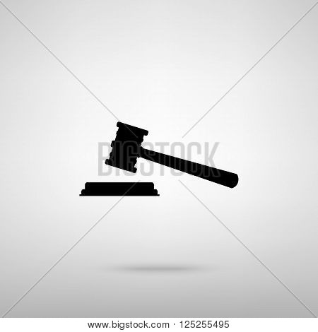 Justice hammer sign. Black with shadow on gray.