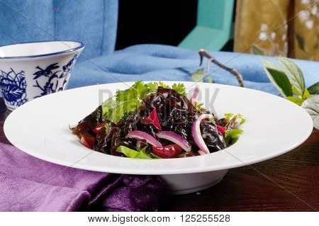 Chinese salad with mushrooms shiitake still life, red onion, restaurant, vase
